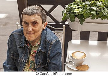 Elderly disabled man with cerebral
