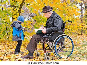Elderly disabled man with his grandson