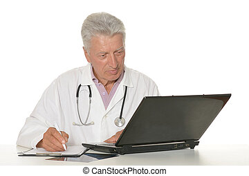 Elderly doctor with a laptop