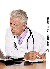 Elderly doctor with a laptop on white background