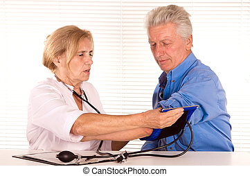 elderly doctor with patient