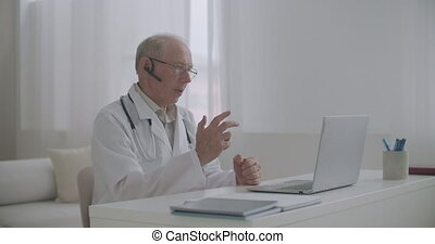 elderly experienced male professor of medicine is lecturing ...