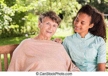 Elderly female and private carer