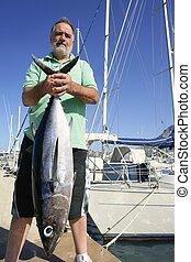 Elderly fisherman with Albacore tuna catch