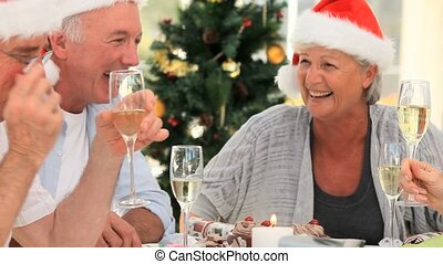 Elderly friends celebrating in the dinning room