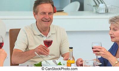 Elderly friends celebrating something