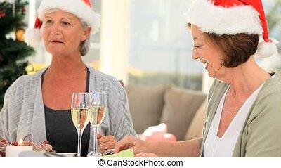 Elderly friends eating cake to celebrate a birthday