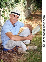 elderly gentleman reading
