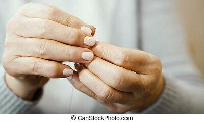 Elderly hands. Elderly hands sew cloth