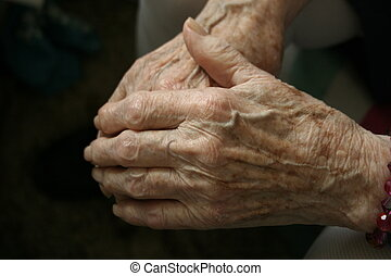 Elderly woman resting her hands