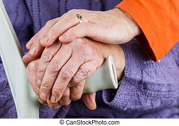 Elderly hands resting on stick - Young carer giving helping...