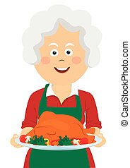 Elderly happy woman holding a tray with thanksgiving turkey
