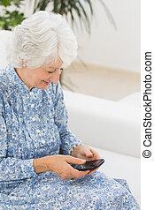 Elderly happy woman using a smartphone