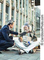 Elderly hippy fugitive talking to governmental worker -...