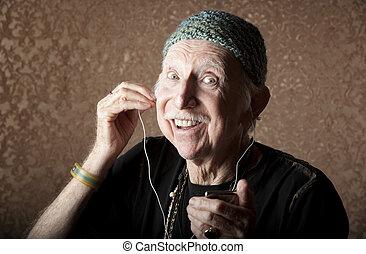 Elderly Hiptser Listening to Handheld Audio Device - Elderly...
