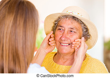 Elderly home care - Happy elderly woman enjoy the time with...