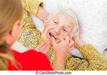 Elderly home care - Photo of elderly woman taking the ...