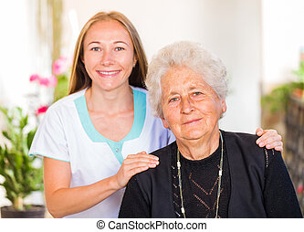 Elderly home care - Photo of happy elderly woman with her ...