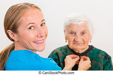Elderly home care - Photo of elderly woman dressed by the...