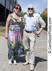 Elderly husband and wife for a walk