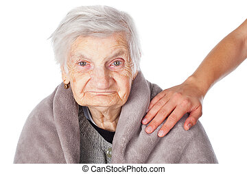 Elderly ill woman with blanket
