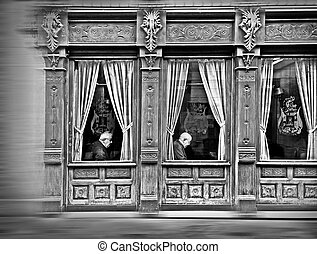 elderly in the windows of an old casino
