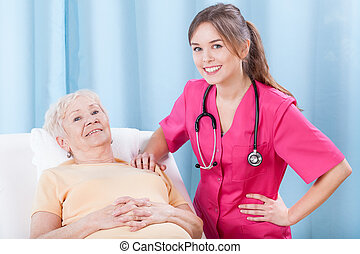 Elderly lady and her doctor - Elderly lady and her smiling...