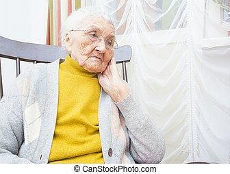 Elderly lady contemplating