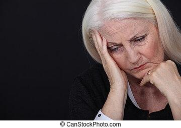Elderly lady in pain