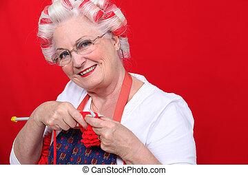 Elderly lady knitting