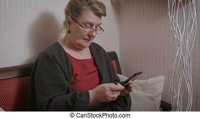 elderly lady makes a purchase through the Internet with a credit card