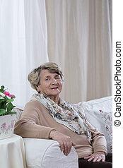 Elderly lady on the sofa