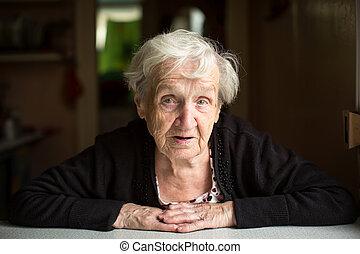 Elderly lady portrait inside