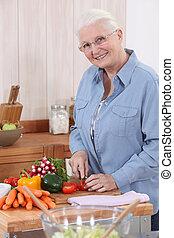 Elderly lady preparing vegetables