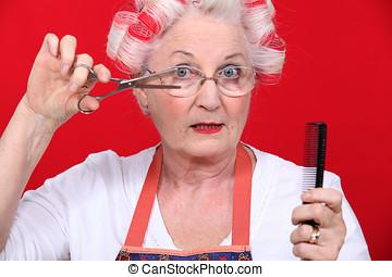 Elderly lady styling own hair