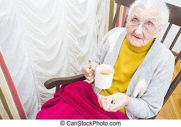 Elderly lady taking medication