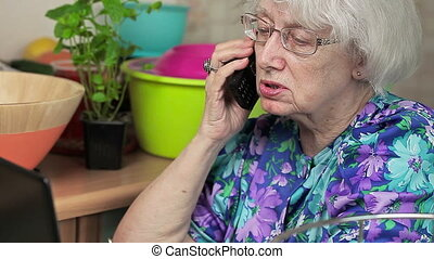 Elderly lady talking on the cell
