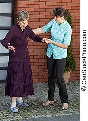Elderly lady trying to walk