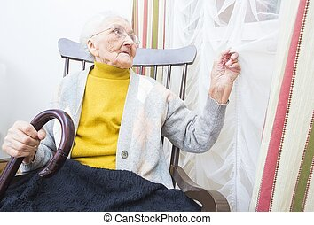 Elderly lady waiting for visitors