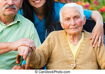 Elderly woman surrounded by family and doctor.