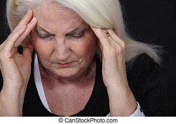 Elderly lady with bad headache
