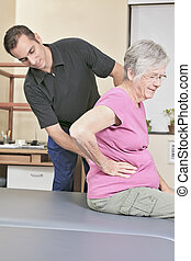 Elderly lady with her physiotherapist in a hospital