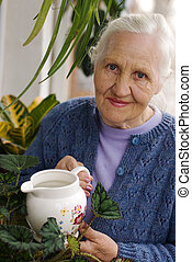 Elderly lady with plants