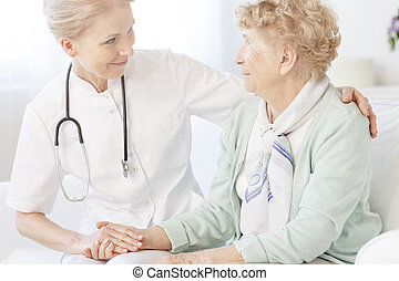 Elderly looking at smiling doctor