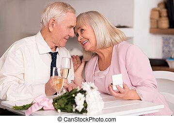 Elderly love birds enjoying emotional moment - I love you....