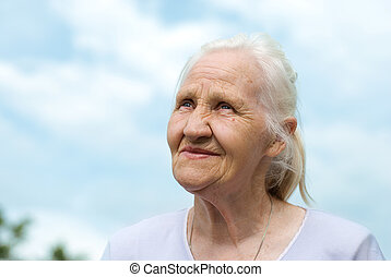 Elderly lovely woman at the blue sk