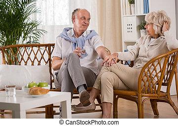 Elderly loving couple holding hands