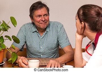 man and nurse having a conversation