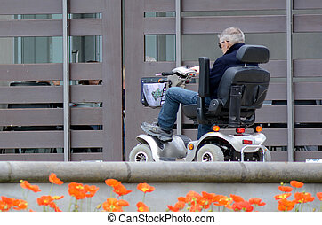 Elderly man drive mobility scoote - AUCKLAND, NZL - OCT 01...
