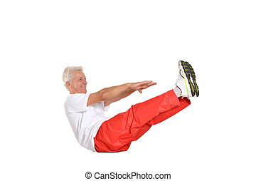 Elderly man exercising in a gym isolated on white background